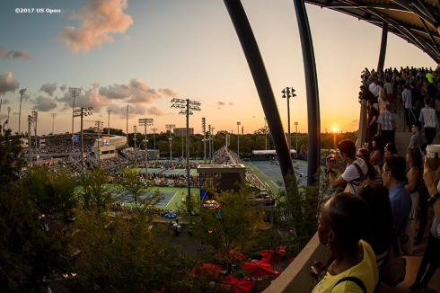 August 30, 2017, New York City, NY: Fans look on as the sun sets during the 2017 US Open Tennis Championships at the Billie Jean King National Tennis Center in New York, New York Wednesday, August 30, 2017. (Photo by Billie Weiss/US Open Tennis Championships)