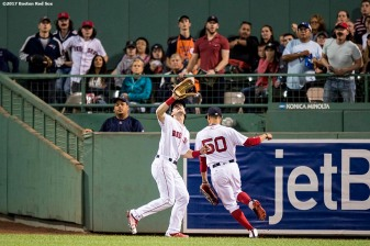 BOSTON, MA - SEPTEMBER 4: Andrew Benintendi #16 of the Boston Red Sox catches a fly ball as Mookie Betts gets out of the way during the fifth inning of a game against the Toronto Blue Jays on September 4, 2017 at Fenway Park in Boston, Massachusetts. (Photo by Billie Weiss/Boston Red Sox/Getty Images) *** Local Caption *** Andrew Benintendi; Mookie Betts