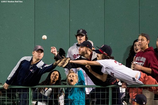 BOSTON, MA - SEPTEMBER 4: Fans reach for a ground rule double hit by Brock Holt #12 of the Boston Red Sox during the eighth inning of a game against the Toronto Blue Jays on September 4, 2017 at Fenway Park in Boston, Massachusetts. (Photo by Billie Weiss/Boston Red Sox/Getty Images) *** Local Caption ***