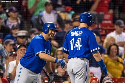 BOSTON, MA - SEPTEMBER 4: Justin Smoak #14 high fives Kendrys Morales #8 of the Toronto Blue Jays after hitting a home run during the ninth inning of a game against the Boston Red Sox on September 4, 2017 at Fenway Park in Boston, Massachusetts. (Photo by Billie Weiss/Boston Red Sox/Getty Images) *** Local Caption *** Justin Smoak; Kendrys Morales