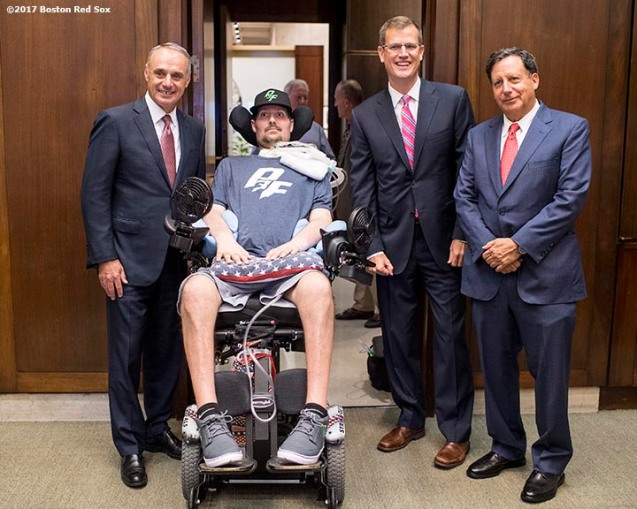 September 5, 2017, Boston, MA: Major League Baseball Commissioner Rob Manfred, Boston Red Sox President and CEO Sam Kennedy, and Boston Red Sox Chairman Tom Werner pose for a photograph with ALS survivor Pete Frates during the proclamation of Pete Frates Day at City Hall in Boston, Massachusetts Tuesday, September 5, 2017. (Photo by Billie Weiss/Boston Red Sox)