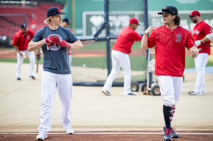 BOSTON, MA - SEPTEMBER 5: Brock Holt #12 and Andrew Benintendi #16 of the Boston Red Sox talk before a game against the Toronto Blue Jays on September 5, 2017 at Fenway Park in Boston, Massachusetts. (Photo by Billie Weiss/Boston Red Sox/Getty Images) *** Local Caption *** Brock Holt; Andrew Benintendi