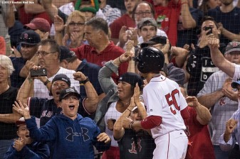 BOSTON, MA - SEPTEMBER 5: Mookie Betts #50 of the Boston Red Sox high fives fans after scoring the game tying run during the ninth inning of a game against the Toronto Blue Jays on September 5, 2017 at Fenway Park in Boston, Massachusetts. (Photo by Billie Weiss/Boston Red Sox/Getty Images) *** Local Caption *** Mookie Betts