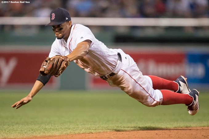 BOSTON, MA - SEPTEMBER 5: Xander Bogaerts #10 of the Boston Red Sox makes a diving stop during the tenth inning of a game against the Toronto Blue Jays on September 5, 2017 at Fenway Park in Boston, Massachusetts. (Photo by Billie Weiss/Boston Red Sox/Getty Images) *** Local Caption *** Xander Bogaerts
