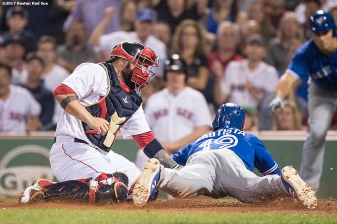 BOSTON, MA - SEPTEMBER 5: Sandy Leon #3 of the Boston Red Sox tags out Jose Bautista #19 of the Toronto Blue Jays at home plate during the eleventh inning of a game on September 5, 2017 at Fenway Park in Boston, Massachusetts. (Photo by Billie Weiss/Boston Red Sox/Getty Images) *** Local Caption *** Sandy Leon; Jose Bautista