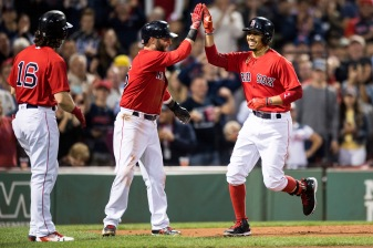 BOSTON, MA - SEPTEMBER 8: Mookie Betts #50 of the Boston Red Sox high fives Dustin Pedroia #15 and Andrew Benintendi #16 after hitting a three run home run during the first inning of a game against the Tampa Bay Rays on September 8, 2017 at Fenway Park in Boston, Massachusetts. (Photo by Billie Weiss/Boston Red Sox/Getty Images) *** Local Caption *** Mookie Betts; Dustin Pedroia; Andrew Benintendi