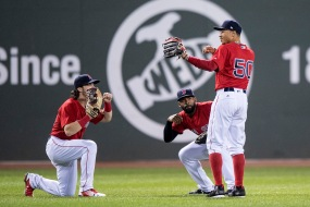 BOSTON, MA - SEPTEMBER 8: Andrew Benintendi #16, Jackie Bradley Jr. #19, and Mookie Betts #50 of the Boston Red Sox celebrate a victory against the Tampa Bay Rays on September 8, 2017 at Fenway Park in Boston, Massachusetts. (Photo by Billie Weiss/Boston Red Sox/Getty Images) *** Local Caption *** Andrew Benintendi; Jackie Bradley Jr.; Mookie Betts