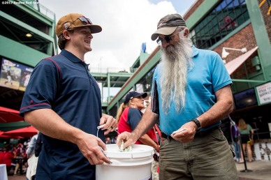 BOSTON, MA - SEPTEMBER 10: Torey Krug of the Boston Bruins collects money at the gates for Hurricane Irma relief before a game between the Boston Red Sox and the Tampa Bay Rays on September 10, 2017 at Fenway Park in Boston, Massachusetts. (Photo by Billie Weiss/Boston Red Sox/Getty Images) *** Local Caption *** Torey Krug