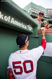 BOSTON, MA - SEPTEMBER 10: Mookie Betts #50 of the Boston Red Sox signs autographs before a game against the Tampa Bay Rays on September 10, 2017 at Fenway Park in Boston, Massachusetts. (Photo by Billie Weiss/Boston Red Sox/Getty Images) *** Local Caption *** Mookie Betts