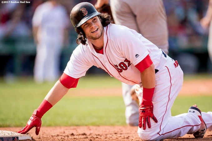 BOSTON, MA - SEPTEMBER 10: Andrew Benintendi #16 of the Boston Red Sox reacts after sliding in to first base during the sixth inning of a game against the Tampa Bay Rays on September 10, 2017 at Fenway Park in Boston, Massachusetts. (Photo by Billie Weiss/Boston Red Sox/Getty Images) *** Local Caption *** Andrew Benintendi