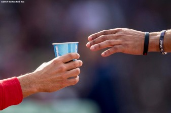 BOSTON, MA - SEPTEMBER 10: Mookie Betts #50 of the Boston Red Sox is handed a cup of water during the sixth inning of a game against the Tampa Bay Rays on September 10, 2017 at Fenway Park in Boston, Massachusetts. (Photo by Billie Weiss/Boston Red Sox/Getty Images) *** Local Caption *** Mookie Betts