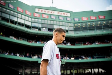 BOSTON, MA - SEPTEMBER 10: Boston Celtics first round draft pick Jayson Tatum is introduced before throwing out the ceremonial first pitch before a game between the Boston Red Sox and the Tampa Bay Rays on September 10, 2017 at Fenway Park in Boston, Massachusetts. (Photo by Billie Weiss/Boston Red Sox/Getty Images) *** Local Caption *** Jayson Tatum