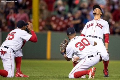 BOSTON, MA - SEPTEMBER 12: Mookie Betts #50 of the Boston Red Sox celebrates a victory with Rajai Davis #25 and Chris Young #30 against the Oakland Athletics on September 12, 2017 at Fenway Park in Boston, Massachusetts. (Photo by Billie Weiss/Boston Red Sox/Getty Images) *** Local Caption *** Mookie Betts; Rajai Davis; Chris Young