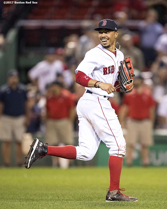 BOSTON, MA - SEPTEMBER 12: Mookie Betts #50 of the Boston Red Sox reacts after a victory against the Oakland Athletics on September 12, 2017 at Fenway Park in Boston, Massachusetts. (Photo by Billie Weiss/Boston Red Sox/Getty Images) *** Local Caption *** Mookie Betts