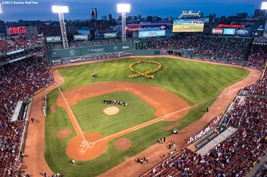 BOSTON, MA - SEPTEMBER 12: Participants form a human ribbon in centerfield during a Go Gold For Cancer childhood cancer awareness pre-game ceremony before a game between the Boston Red Sox and the Oakland Athletics on September 12, 2017 at Fenway Park in Boston, Massachusetts. (Photo by Billie Weiss/Boston Red Sox/Getty Images) *** Local Caption ***
