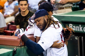 BOSTON, MA - SEPTEMBER 13: Hanley Ramirez #13 of the Boston Red Sox hugs a young fan before a game against the Oakland Athletics on September 13, 2017 at Fenway Park in Boston, Massachusetts. (Photo by Billie Weiss/Boston Red Sox/Getty Images) *** Local Caption *** Hanley Ramirez