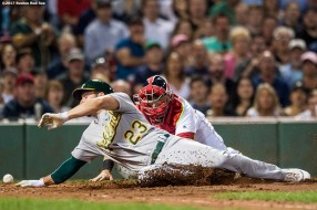 BOSTON, MA - SEPTEMBER 13: Sandy Leon #3 of the Boston Red Sox mishandles a thrown ball as Matt Joyce #23 of the Oakland Athletics scores during the third inning of a game on September 13, 2017 at Fenway Park in Boston, Massachusetts. (Photo by Billie Weiss/Boston Red Sox/Getty Images) *** Local Caption *** Sandy Leon; Matt Joyce