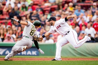 BOSTON, MA - SEPTEMBER 14: Mitch Moreland #18 of the Boston Red Sox tags out Chad Pinder #18 of the Oakland Athletics as he is caught in a run down during the third inning of a game on September 14, 2017 at Fenway Park in Boston, Massachusetts. (Photo by Billie Weiss/Boston Red Sox/Getty Images) *** Local Caption *** Mitch Moreland; Chad Pinder
