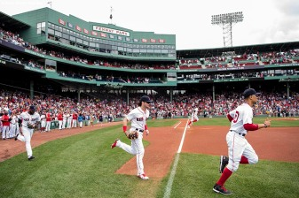 BOSTON, MA - SEPTEMBER 14: Jackie Bradley Jr. #19, Andrew Benintendi #16, and Mookie Betts #50 of the Boston Red Sox take the field before a game against the Oakland Athletics on September 14, 2017 at Fenway Park in Boston, Massachusetts. (Photo by Billie Weiss/Boston Red Sox/Getty Images) *** Local Caption *** Jackie Bradley Jr.; Andrew Benintendi; Mookie Betts