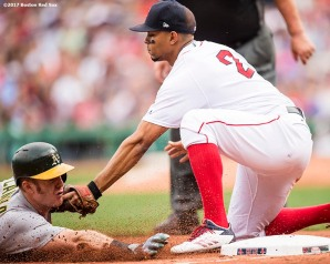 BOSTON, MA - SEPTEMBER 14: Xander Bogaerts #2 of the Boston Red Sox tags out Mark Canha #20 of the Oakland Athletics during the fifth inning of a game on September 14, 2017 at Fenway Park in Boston, Massachusetts. (Photo by Billie Weiss/Boston Red Sox/Getty Images) *** Local Caption *** Xander Bogaerts; Mark Canha