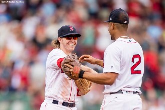 BOSTON, MA - SEPTEMBER 14: Brock Holt #12 and Xander Bogaerts #2 of the Boston Red Sox celebrate a victory against the Oakland Athletics on September 14, 2017 at Fenway Park in Boston, Massachusetts. (Photo by Billie Weiss/Boston Red Sox/Getty Images) *** Local Caption *** Brock Holt; Xander Bogaerts