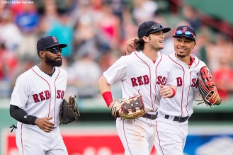 BOSTON, MA - SEPTEMBER 14: CJackie Bradley Jr. #19, Andrew Benintendi #16, and Mookie Betts #50 of the Boston Red Sox celebrate a victory against the Oakland Athletics on September 14, 2017 at Fenway Park in Boston, Massachusetts. (Photo by Billie Weiss/Boston Red Sox/Getty Images) *** Local Caption *** Andrew Benintendi; Jackie Bradley Jr.; Mookie Betts