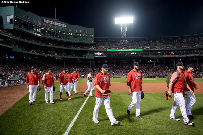 BOSTON, MA - SEPTEMBER 25: Members of the Boston Red Sox bullpen walk toward the bullpen before a game against the Toronto Blue Jays on September 25, 2017 at Fenway Park in Boston, Massachusetts. (Photo by Billie Weiss/Boston Red Sox/Getty Images) *** Local Caption ***