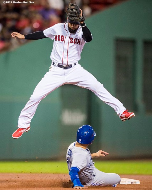 BOSTON, MA - SEPTEMBER 25: Deven Marrero #17 of the Boston Red Sox leaps after catching a ball to tag out Ryan Goins #17 of the Toronto Blue Jays as he attempts to steal second base during the sixth inning of a game on September 25, 2017 at Fenway Park in Boston, Massachusetts. (Photo by Billie Weiss/Boston Red Sox/Getty Images) *** Local Caption *** Deven Marrero; Ryan Goins