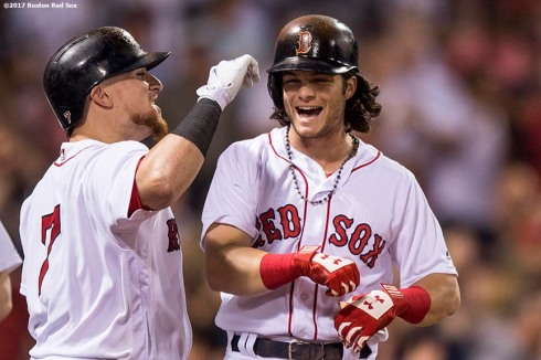 BOSTON, MA - SEPTEMBER 25: Andrew Benintendi #16 of the Boston Red Sox reacts with Christian Vazquez #7 after hitting a pinch hit solo home run during the ninth inning of a game against the Toronto Blue Jays on September 25, 2017 at Fenway Park in Boston, Massachusetts. (Photo by Billie Weiss/Boston Red Sox/Getty Images) *** Local Caption *** Andrew Benintendi; Christian Vazquez