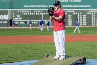 BOSTON, MA - SEPTEMBER 27: Brock Holt #12 of the Boston Red Sox pretends to pitch before a game against the Toronto Blue Jays on September 27, 2017 at Fenway Park in Boston, Massachusetts. (Photo by Billie Weiss/Boston Red Sox/Getty Images) *** Local Caption *** Brock Holt
