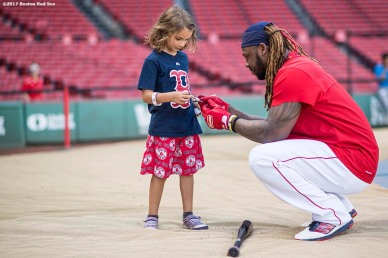 BOSTON, MA - SEPTEMBER 27: Hanley Ramirez #13 of the Boston Red Sox signs an autograph for a young fan before a game against the Toronto Blue Jays on September 27, 2017 at Fenway Park in Boston, Massachusetts. (Photo by Billie Weiss/Boston Red Sox/Getty Images) *** Local Caption *** Hanley Ramirez