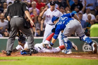 BOSTON, MA - SEPTEMBER 27: Xander Bogaerts #2 of the Boston Red Sox evades the tag of Russell Martin #55 of the Toronto Blue Jays as he scores during the second inning of a game on September 27, 2017 at Fenway Park in Boston, Massachusetts. (Photo by Billie Weiss/Boston Red Sox/Getty Images) *** Local Caption *** Xander Bogaerts; Russell Martin
