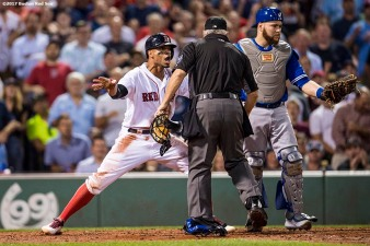 BOSTON, MA - SEPTEMBER 27: Xander Bogaerts #2 of the Boston Red Sox argues with home plate umpire Larry Vanover #27 after being called out on a tag by Russell Martin #55 of the Toronto Blue Jays attempting to score during the second inning of a game on September 27, 2017 at Fenway Park in Boston, Massachusetts. The play was overruled upon review. (Photo by Billie Weiss/Boston Red Sox/Getty Images) *** Local Caption *** Xander Bogaerts; Russell Martin; Larry Vanover