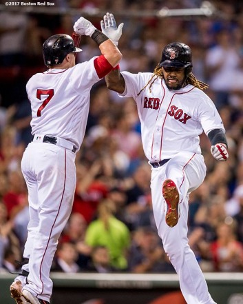 BOSTON, MA - SEPTEMBER 27: Hanley Ramirez #13 of the Boston Red Sox reacts with Christian Vazquez #7 after hitting a solo home run during the third inning of a game against the Toronto Blue Jays on September 27, 2017 at Fenway Park in Boston, Massachusetts. (Photo by Billie Weiss/Boston Red Sox/Getty Images) *** Local Caption *** Hanley Ramirez; Christian Vazquez