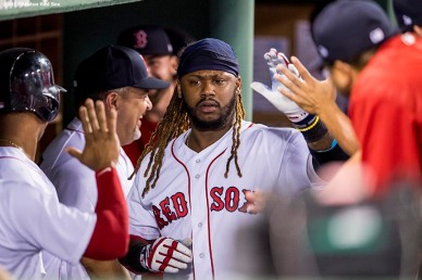 BOSTON, MA - SEPTEMBER 27: Hanley Ramirez #13 of the Boston Red Sox high fives teammates after hitting a solo home run during the third inning of a game against the Toronto Blue Jays on September 27, 2017 at Fenway Park in Boston, Massachusetts. (Photo by Billie Weiss/Boston Red Sox/Getty Images) *** Local Caption *** Hanley Ramirez