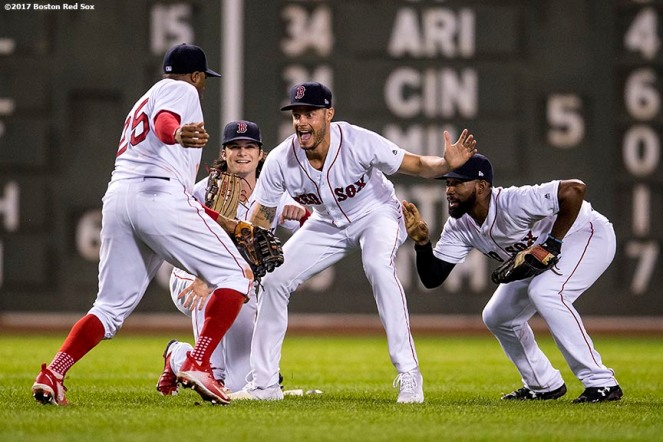 BOSTON, MA - SEPTEMBER 27: Rajai Davis #25 of the Boston Red Sox, Andrew Benintendi #16, Joe Kelly #56, and Jackie Bradley Jr. #19 celebrate a victory against the Toronto Blue Jays on September 27, 2017 at Fenway Park in Boston, Massachusetts. (Photo by Billie Weiss/Boston Red Sox/Getty Images) *** Local Caption *** Rajai Davis; Andrew Benintendi; Joe Kelly; Jackie Bradley Jr.