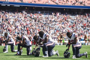 FOXBORO, MA - SEPTEMBER 24: Members of the Houston Texans kneel before a game against the New England Patriots at Gillette Stadium on September 24, 2017 in Foxboro, Massachusetts. (Photo by Billie Weiss/Getty Images)