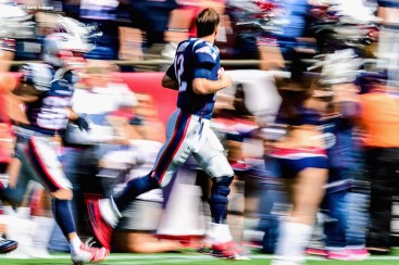 FOXBORO, MA - SEPTEMBER 24: Tom Brady #12 of the New England Patriots runs onto the field before a game against the Houston Texans at Gillette Stadium on September 24, 2017 in Foxboro, Massachusetts. (Photo by Billie Weiss/Getty Images) *** Local Caption *** Tom Brady