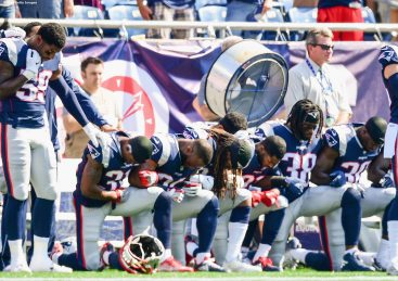 FOXBORO, MASSACHUSETTS - SEPTEMBER 24: Members of the New England Patriots kneel on the sidelines as the National Anthem is played before a game against the Houston Texans at Gillette Stadium on September 24, 2017 in Foxboro, Massachusetts. (Photo by Billie Weiss/Getty Images)
