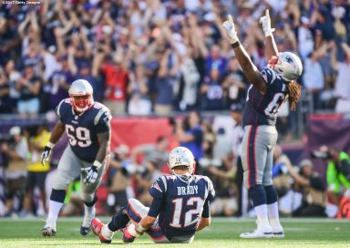 FOXBORO, MASSACHUSETTS - SEPTEMBER 24: Tom Brady #12, Shaq Mason #69, and LaAdrian Waddle #68 of the New England Patriots react after the game winning touchdown in the fourth quarter was scored against the Houston Texans at Gillette Stadium on September 24, 2017 in Foxboro, Massachusetts. (Photo by Billie Weiss/Getty Images) *** Local Caption *** Tom Brady;Shaq Mason;LaAdrian Waddle