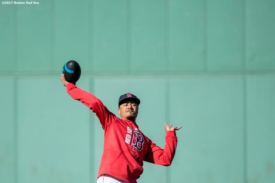 BOSTON, MA - SEPTEMBER 29: Mookie Betts #50 of the Boston Red Sox throws a football before a game against the Houston Astros on September 29, 2017 at Fenway Park in Boston, Massachusetts. (Photo by Billie Weiss/Boston Red Sox/Getty Images) *** Local Caption *** Mookie Betts