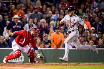 BOSTON, MA - SEPTEMBER 29: Derek Fisher #21 of the Houston Astros scores past the tag of Sandy Leon #3 of the Boston Red Sox during the third inning of a game on September 29, 2017 at Fenway Park in Boston, Massachusetts. (Photo by Billie Weiss/Boston Red Sox/Getty Images) *** Local Caption *** Derek Fisher; Sandy Leon