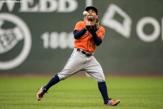 BOSTON, MA - SEPTEMBER 30: Jose Altuve #27 of the Houston Astros catches a fly ball during the third inning of a game against the Boston Red Sox on September 30, 2017 at Fenway Park in Boston, Massachusetts. (Photo by Billie Weiss/Boston Red Sox/Getty Images) *** Local Caption *** Jose Altuve