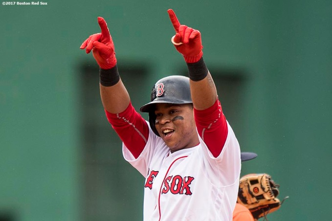 BOSTON, MA - SEPTEMBER 30: Rafael Devers #11 of the Boston Red Sox reacts after hitting an RBI double during the fourth inning of a game against the Houston Astros on September 30, 2017 at Fenway Park in Boston, Massachusetts. (Photo by Billie Weiss/Boston Red Sox/Getty Images) *** Local Caption *** Rafael Devers