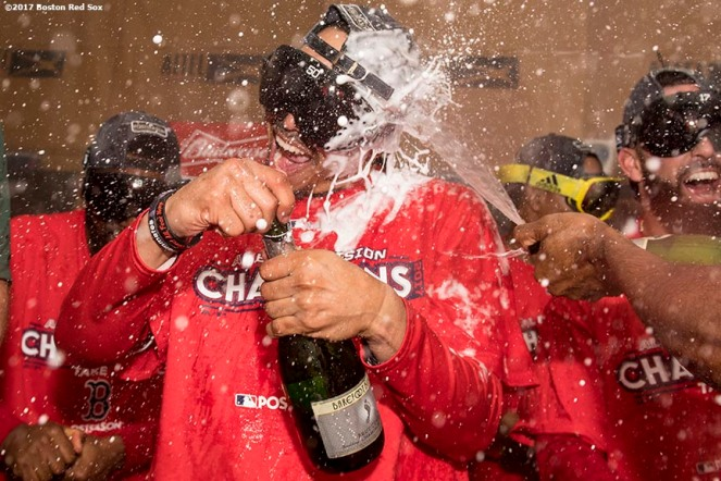 BOSTON, MA - SEPTEMBER 30: Mookie Betts #50 celebrates in the clubhouse after clinching the American League East Division against the Houston Astros on September 30, 2017 at Fenway Park in Boston, Massachusetts. (Photo by Billie Weiss/Boston Red Sox/Getty Images) *** Local Caption *** Mookie Betts
