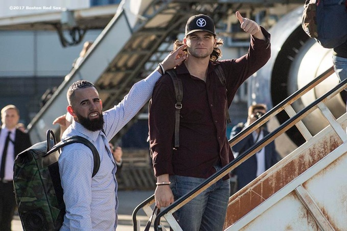 BOSTON, MA - OCTOBER 3: Deven Marrero #17 and Andrew Benintendi #16 of the Boston Red Sox boards the plane to Houston before the American League Division Series against the Houston Astros on October 3, 2017 at Fenway Park in Boston, Massachusetts. (Photo by Billie Weiss/Boston Red Sox/Getty Images) *** Local Caption *** Deven Marrero; Andrew Benintendi