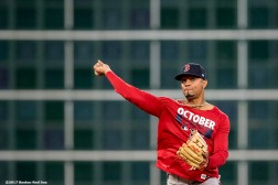 HOUSTON, TX - OCTOBER 4: Xander Bogaerts #2 of the Boston Red Sox throws during a workout before the American League Division Series against the Houston Astros on October 4, 2017 at Minute Maid Park in Houston, Texas. (Photo by Billie Weiss/Boston Red Sox/Getty Images) *** Local Caption *** Xander Bogaerts