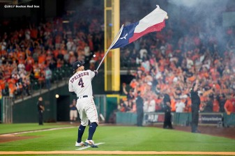 HOUSTON, TX - OCTOBER 5: George Springer #4 of the Houston Astros waves a Texas flag before game one of the American League Division Series against the Boston Red Sox on October 5, 2017 at Minute Maid Park in Houston, Texas. (Photo by Billie Weiss/Boston Red Sox/Getty Images) *** Local Caption *** George Springer