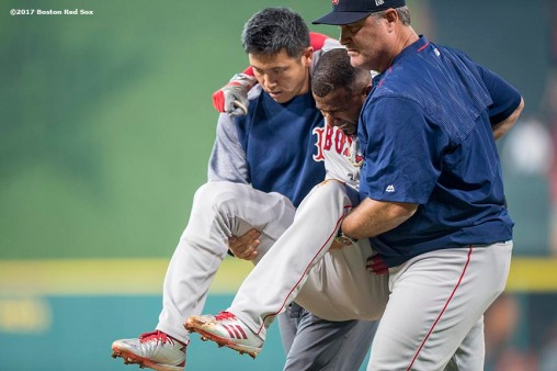 HOUSTON, TX - OCTOBER 5: Manager JOhn Farrell and trainer Masai Takahashi tend to Eduardo Nunez #36 of the Boston Red Sox is injured as he runs up the first base line during the first inning of game one of the American League Division Series against the Houston Astros on October 5, 2017 at Minute Maid Park in Houston, Texas. (Photo by Billie Weiss/Boston Red Sox/Getty Images) *** Local Caption *** Eduardo Nunez; Masai Takahashi, John Farrell