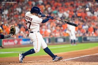 HOUSTON, TX - OCTOBER 5: Jose Altuve #27 of the Houston Astros hits a solo home run during the first inning of game one of the American League Division Series against the Boston Red Sox on October 5, 2017 at Minute Maid Park in Houston, Texas. (Photo by Billie Weiss/Boston Red Sox/Getty Images) *** Local Caption *** Jose Altuve
